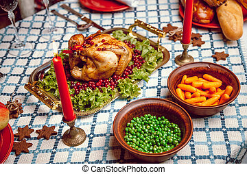 Roasted chicken, table setting Thanksgiving table served...