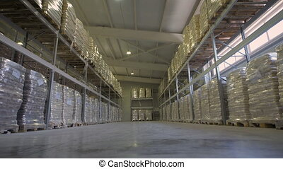 Large furniture warehouse. Mezzanine shelving with large packages of food ready for dispatch. Warehouse wholesaler.