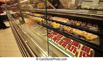 A shop window with cakes, video full hd