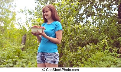 Girl with strawberry. - Handful is fresher than some mature...