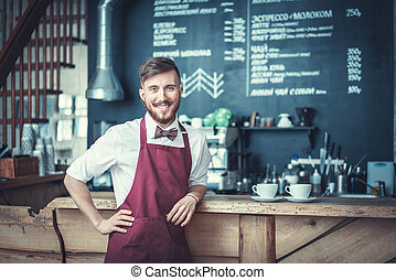 Happy barista - Smiling barista in a coffee shop