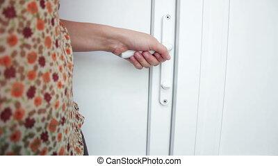 Female hand open doors