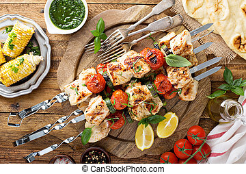 Grilled chicken cabobs on skewers with vegetables