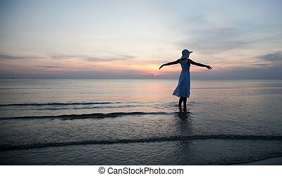 Relaxing woman on the beach - Happy woman on the beachfront...