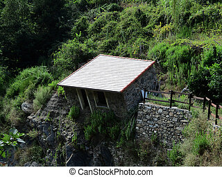 dilapidated house on the creek in Vernazza a - dilapidated...