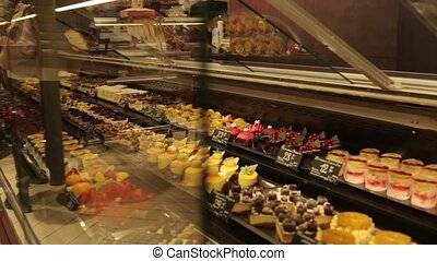 A shop window with cakes