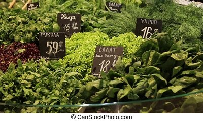 Countertop store with fresh parsley, dill, lettuce and...