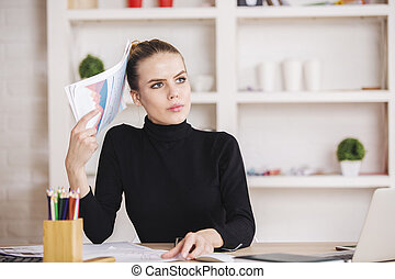 Concentrated female doing paperwork - Portrait of...