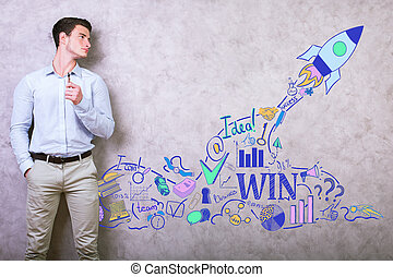 Start up concept - Young businessman standing against...