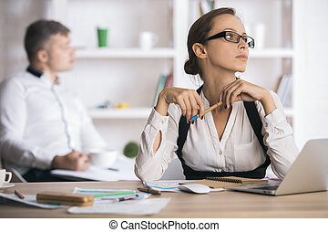 Attractive lady doing paperwork - Portrait of attractive...