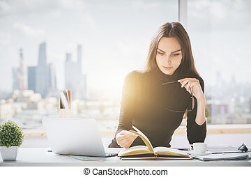 Focused woman working on project - Portrait of focused young...