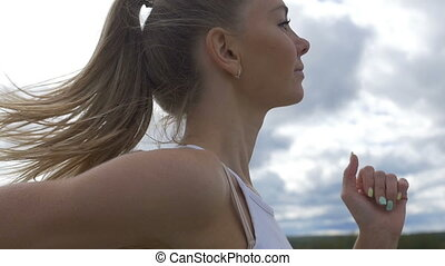 Young attractive girl running