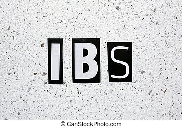 IBS Irritable Bowel Syndrome acronym cut from newspaper on...