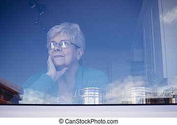 Senior Woman Lost in Thought