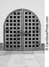 old wooden gate in the wall of a building black and white -...