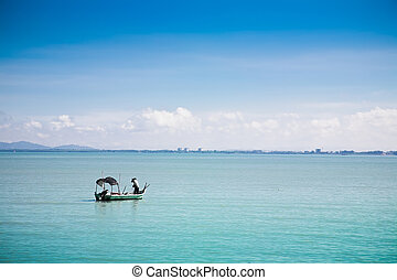 Fisherman under the work - Fishing boat in Penang bay....