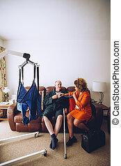 Home Medical Exam - Homecare nurse checking a senior man...