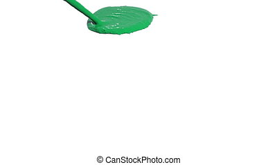 green liquid flow falls on surface. Colored paint - green...