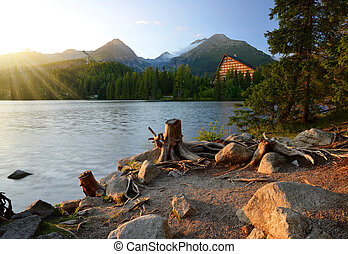 Mountain lake Strbske pleso in National Park High Tatras at...