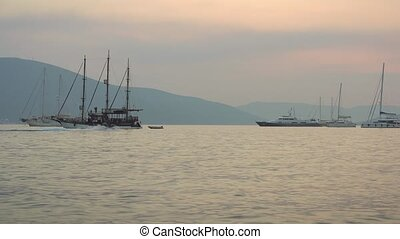 Sunset Regatta of Sailing boats in the Boka bay, Montenegro,...