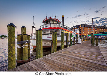 Pier and boat on the waterfront, in Annapolis, Maryland.