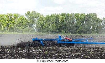 Tractor plow land - Tractor with double wheeled ditcher...
