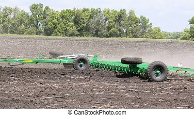 The tractor processes the soil Cultivator