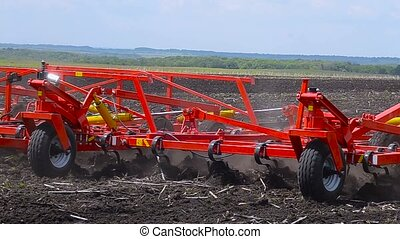 The tractor processes the soil. Cultivator