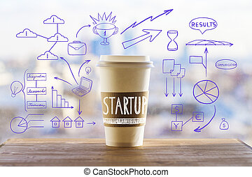 Start up concept with take away coffee cup and abstract...