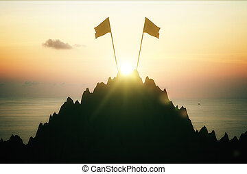 Mountain top with two flags