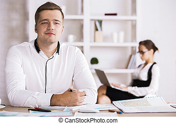 Thoughtful man doing paperwork - Portrait of thoughtful...