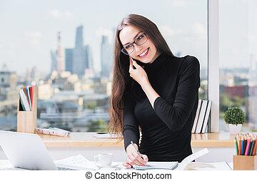 European businesslady working on office - Portrait of...