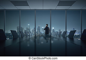 Man talking on phone in office - Young businessman talking...