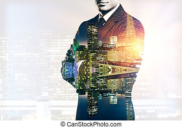 Man on city background multiexposure