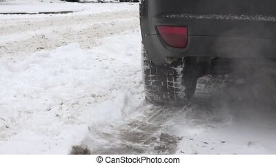 exhaust pipe tailpipe of car standing on snow in winter...