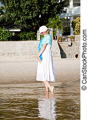 Beachfront - Happy young woman walking on the beach