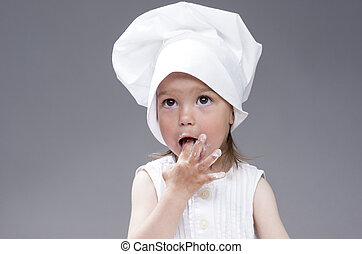 Funny Lovely Cute Caucasian Girl Posing as Cook. Against...