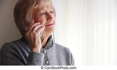 Senior Woman on the Phone - Senior woman talking on the...