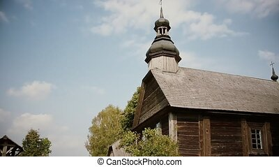 Old wooden Orthodox church on a summer day.