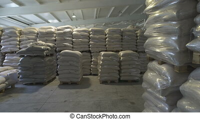 In a warehouse in bags rice, groats and a flour is prepared...