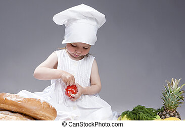 Portrait of Lovely Cute Caucasian Kid Posing as Cook with...
