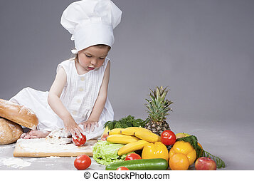 Cooking Concepts. Little Caucasian Girl Posing as Cook with...