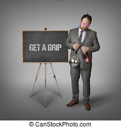 Get a grip text on blackboard with businessman and key