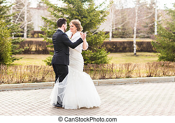 Wedding couple dancing in the park - Young Wedding couple...