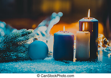 christmas decoration with bauble and candle for advent...