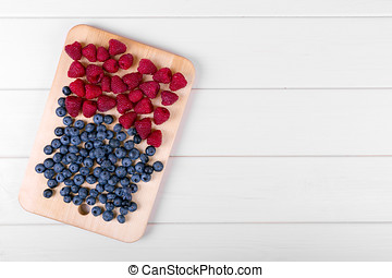 berries on white wooden table with copy space
