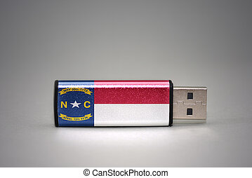 usb flash drive with the north carolina state flag on gray background.
