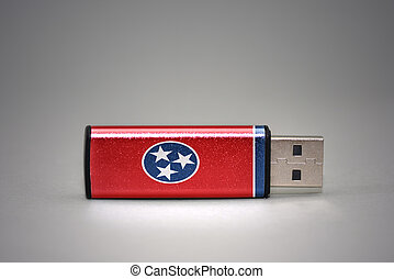 usb flash drive with the tennessee state flag on gray background.