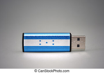 usb flash drive with the national flag of honduras on gray...