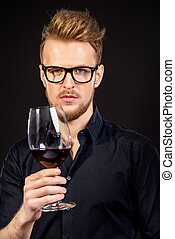 male sommelier - Male sommelier tasting red wine....